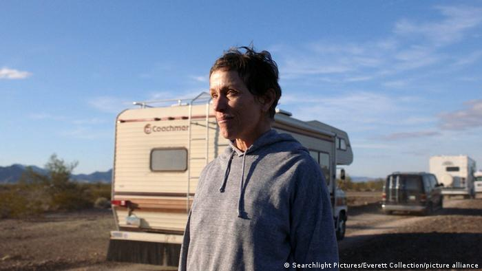 Frances McDormand standing in front of a camper van in a scene from the film.