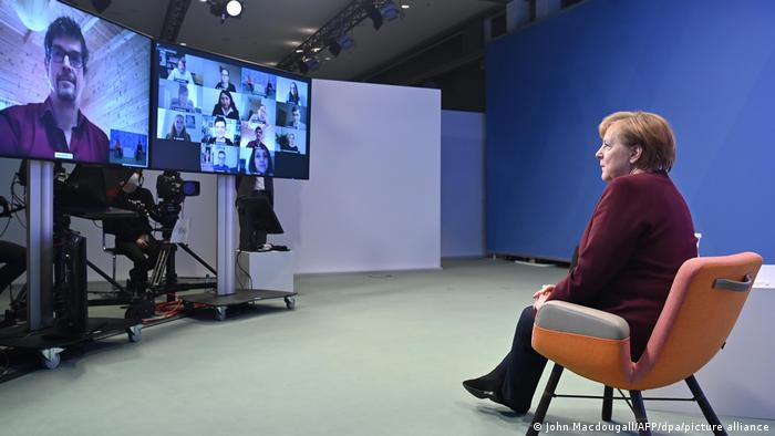 Angela Merkel faces questions from parents in a videoconference