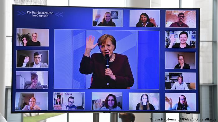 Angela Merkel on a screen surrounded by parents participating in a virtual discussion