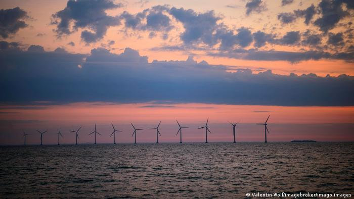 Wind turbines at sea off Denmark at sunset