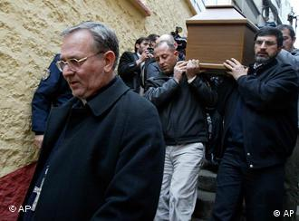 Luigi Padovese walks in front of the coffin of his slain fellow clergyman Andrea Santoro