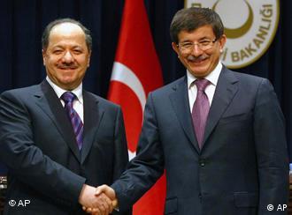 Iraqi Kurdish leader Massoud Barzani and Turkish foreign minister Ahmet Davutoglu