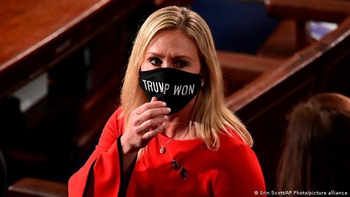 In this Sunday, Jan. 3, 2021, file photo, Rep. Marjorie Taylor Greene, R-Ga., wears a Trump Won face mask as she arrives on the floor of the House to take her oath of office on opening day of the 117th Congress at the U.S. Capitol in Washington.
