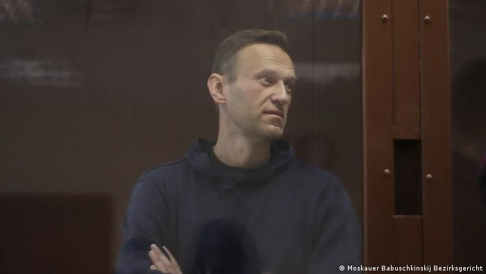 Russian opposition leader Alexei Navalny stands in court for a defamation hearing