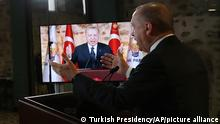 Turkish President Recep Tayyip Erdogan addresses his ruling party members via video link from Ankara, Turkey, Friday, Feb. 5, 2021. Erdogan rebuffed U.S. and European criticism of his government's handling of weeks-long demonstrations at a top Istanbul university, saying they should focus on violent protests in their own countries instead. Erdogan also vowed to show no mercy to protesters who use violence, and reiterated his determination not to allow the demonstrations spiral into mass anti-government protests like those that rocked the country in 2013. (Turkish Presidency via AP, Pool)