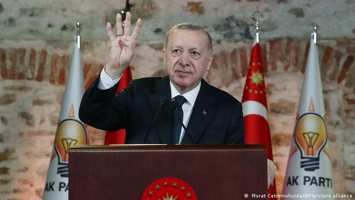 Turkish President Recep Tayyip Erdogan gestures during a speech at a virtual party congress