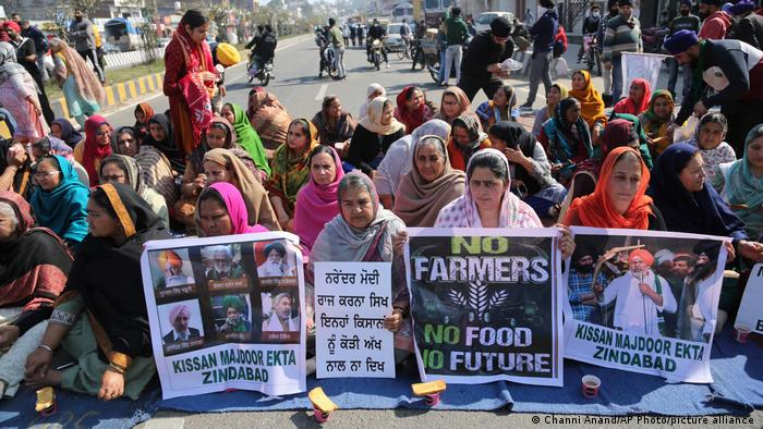 Female farm protesters in India block the Jammu-Pathankot highway in northern India
