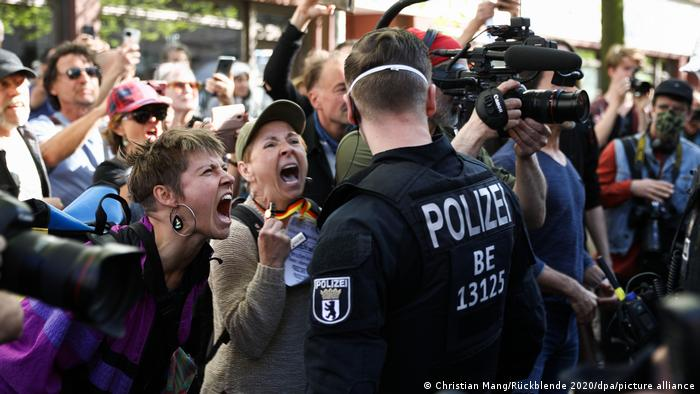 Querdenker protesters in Berlin challenge a police officer during a demonstration