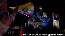 Andres Arauz, who is running for president with the United for Hope alliance, holds an Ecuadorean flag outside of the National Electoral Council after his closing campaign rally in Quito, Ecuador, Thursday, Feb. 4, 2021. Ecuador is heading towards general elections on Feb. 7. (AP Photo / Dolores Ochoa)