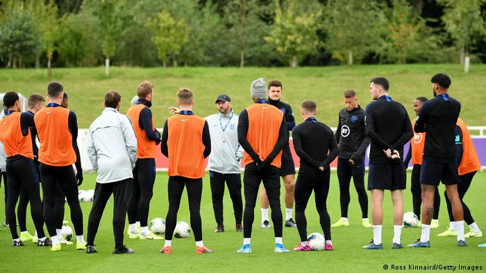 England players listening to instructions during a training session at St. George's Park