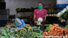 19.05.2020 People wearing face masks shop at a market in Havana, on May 19, 2020, amid the new coronavirus pandemic. - Weakened economically by the coronavirus, Cuba wants to suspend until 2022 the repayment of its debt to the Paris Club, hoping to benefit from the same leniency as African countries with the G20. The government had promised to finish repaying by the end of May. (Photo by YAMIL LAGE / AFP) (Photo by YAMIL LAGE/AFP via Getty Images)