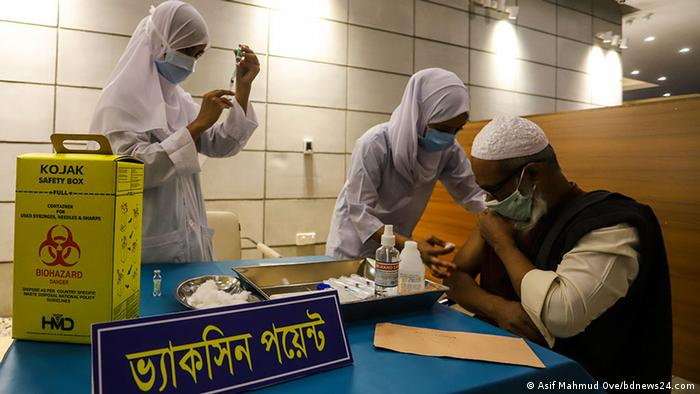 A man in Bangladesh receives his COVID vaccine