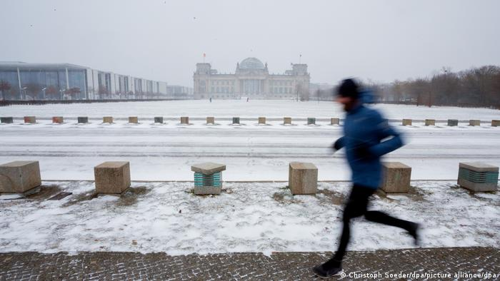 A runner running near the Reichstag building in Berlin