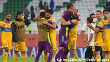 Tigres' players celebrate their win during the FIFA Club World Cup semi-final football match between Brazil's Palmeiras and Mexico's UANL Tigres at the Ahmed bin Ali Stadium in the Qatari city of Ar-Rayyan on February 7, 2021. (Photo by Karim JAAFAR / AFP) (Photo by KARIM JAAFAR/AFP via Getty Images)