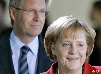 German Chancellor Angela Merkel, right, and the governor of the German state of Lower Saxony, Christian Wulff