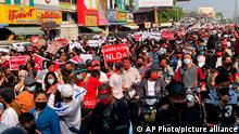 Protesters who are marching and riding motorbikes fill a road in Mandalay, Myanmar on Monday, Feb. 8, 2021. A protest against Myanmar's one-week-old military government swelled rapidly Monday morning as opposition to the coup grew increasingly bold. (AP Photo)