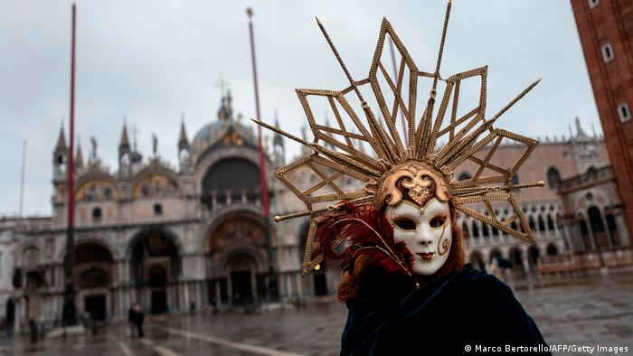 A masked person on St. Mark's square