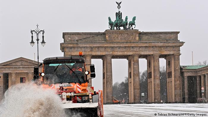 The Brandenburg Gate is cleared during heavy snowfall.