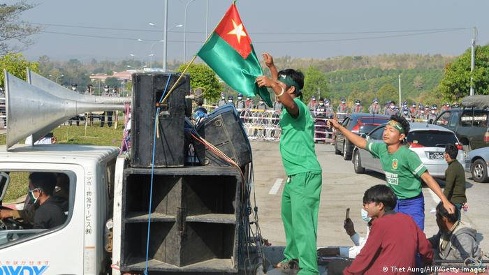 Pro-military demonstrators on the back of a flatbed truck in Naypyitaw