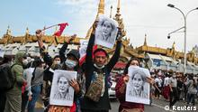 People hold placards depicting leader Aung San Suu Kyi during a rally to demand her release and protest against the military coup, in Yangon, Myanmar, February 8, 2021. REUTERS/Stringer