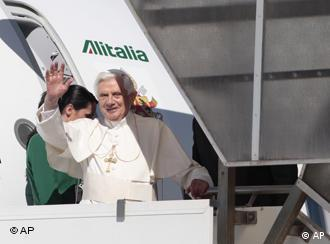 Pope waving as he gets on the plane to Cyprus