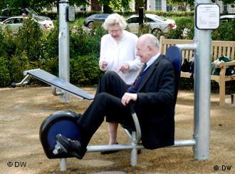 Mrs. Mary Thronton, 86, puts Horton Kennedy through his steps at a playground for seniors in London's Hyde Park.