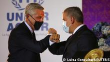 Iván Duque, dio a conocer la medida en compañía del Alto Comisionado de la ACNUR, Grandi (izq.)