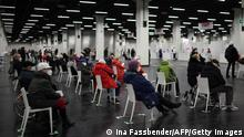 People waiting for their vaccine at a vaccination center in Cologne