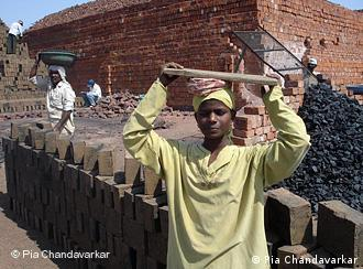 12-year-old Manisha Khandavale works at a brick kiln after dropping out of school