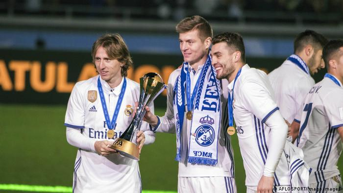 Luka Modric and Toni Kroos lift the Club World Cup