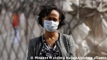 ADDIS ABABA, ETHIOPIA - APRIL 16: Lia Tadesse, the Health Minister of Ethiopia welcomes the plane carrying 12 Chinese medical staff and medical aid from China at International Bole Airport in Addis Ababa, Ethiopia on April 16, 2020. Minasse Wondimu Hailu / Anadolu Agency