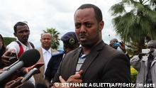 This picture taken on April 15, 2014 shows Rwandan musician Kizito Mihigo speaking to the media in Kigali. Police in Rwanda said on April 14, 2014 they had arrested three people on charges of threatening state security, among them a radio journalist and Mihigo, a famous peace activist musician. In a statement police said the three are accused of connections with the Rwanda National Congress (RNC), an opposition party in exile.They are also accused of working for some time in collaboration with the FDLR, Rwandan Hutu rebels who include the perpetrators of the 1994 genocide in their ranks and who are based in the forests of neighbouring DR Congo. According to the police, musician Kizito Mihigo was arrested on April 11, demobilised soldier Jean Paul Dukuzumuremyi over the weekend, while Cassien Ntamuhanga, a journalist at Amazing Grace Radio who had earlier been reported missing, was taken in on April 14. AFP PHOTO / STEPHANIE AGLIETTI (Photo credit should read STEPHANIE AGLIETTI/AFP via Getty Images)