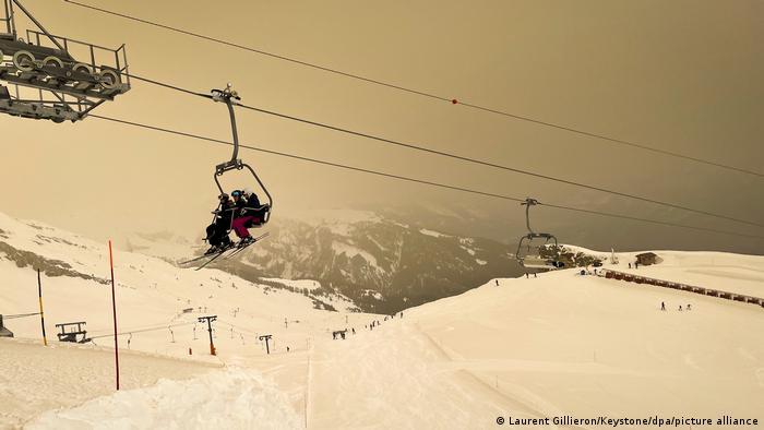 Ski lift in Switzerland against orange snow