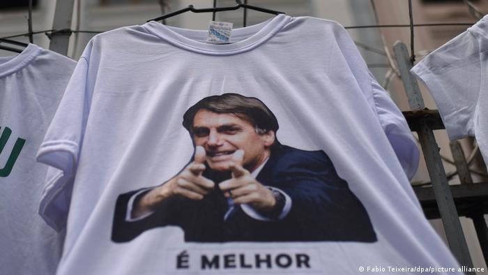 Image of Bolsonaro on a t-shirt doing finger guns