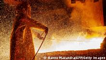 30.03.2019 TOPSHOT - This picture taken on March 30, 2019 shows a worker manning a furnace during the nickel smelting process at Indonesian mining company PT Vale's smelting plant in Soroako, South Sulawesi. - Indonesia's surprise plan to roll out a nickel-ore export ban two years early could scare foreign investors away from Southeast Asia's biggest economy, analysts say, as it cements a reputation for policy flip-flops. (Photo by Bannu MAZANDRA / AFP) / TO GO WITH Indonesia-mining-economy-politics,FOCUS by Peter Brieger (Photo credit should read BANNU MAZANDRA/AFP via Getty Images)