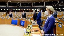 European Commission President Ursula von der Leyen, right, wears a protective face mask prior to addressing the plenary during a debate on the united EU approach to COVID-19 vaccinations at the European Parliament in Brussels, Wednesday, Feb. 10, 2021. (Johanna Geron, Pool via AP)