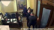 10.02.2021 In this image from video, a security video shows Vice President Mike Pence being evacuated as rioters breach the Capitol, as House impeachment manager Del. Stacey Plaskett, D-Virgin Islands, speaks during the second impeachment trial of former President Donald Trump in the Senate at the U.S. Capitol in Washington, Wednesday, Feb. 10, 2021. (Senate Television via AP)
