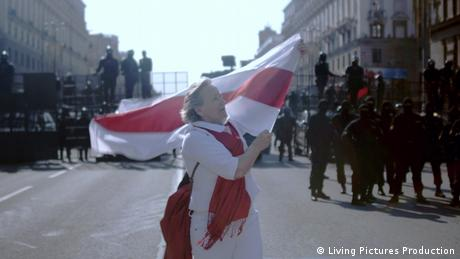 A woman carried a red and white flag in front of police