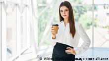 Portrait of elegant businessman with cup of coffee in hand during break time in modern creative office with copy space. Relax, success concept
