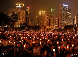 Thousands of people raise candles during a candlelight vigil at Hong Kong's Victoria Park Friday, June 4, 2010, to mark the 21st anniversary of the June 4th military crackdown on the pro-democracy movement in Beijing. (AP Photo/Vincent Yu)