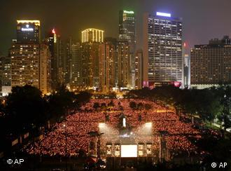 Tens of thousands of people attend a candlelight vigil at Hong Kong's Victoria Park Friday, June 4, 2010, to mark the 21st anniversary of the June 4th Chinese military crackdown on the pro-democracy movement in Beijing. (AP Photo/Kin Cheung)