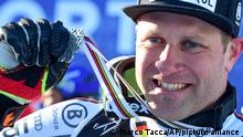 Germany's Romed Baumann shows his silver medal for the men's super-G, at the alpine ski World Championships, in Cortina d'Ampezzo, Italy, Thursday, Feb. 11, 2021. (AP Photo/Marco Tacca)