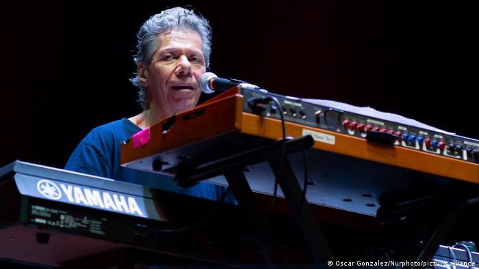 Chick Corea sings at a keyboard in an image frrom 2019