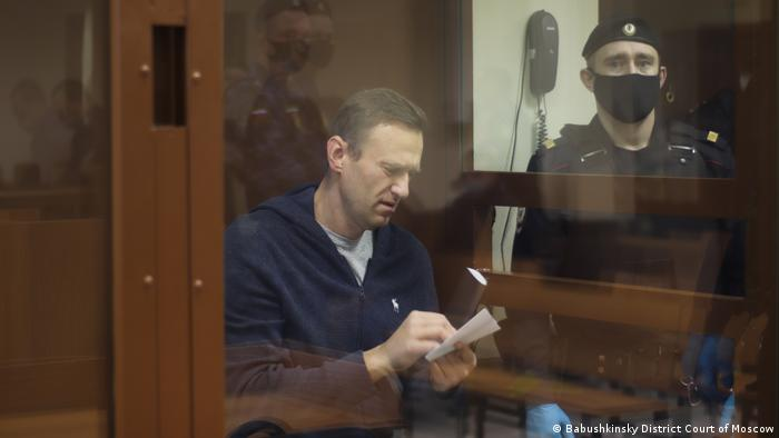 Navalny taking notes while in court