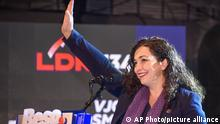 In this Saturday, Sept. 28, 2019 photo, Vjosa Osmani of the LDK political party and candidate for prime minister, waves at her supporters during a political rally in the town of Gjakove, Kosovo. Kosovo holds an early general election on Sunday after outgoing prime minister resigned following a request from a Hague-based court to be questioned on crimes against ethnic Serbs during and after the country's 1998-99 war. (AP Photo)