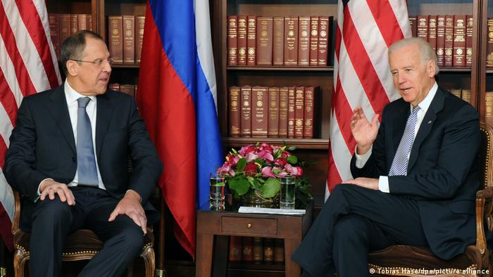 Rusisian Foreign Minister Sergey Lavrov (L) and US then-Vice President Joe Biden talk during bilateral talks at the 49th Munich Conference on Security Policy in Munich, Germany, February 2, 2013.