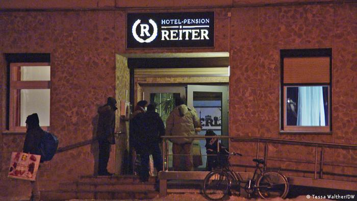 Homeless men outside the main entrance of Pension Reiter