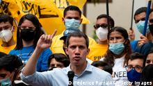 Venezuelan opposition leader Juan Guaido gestures as he delivers a speech to students on the commemoration of the Youth Day at the Bolivar Square of the Chacao neighborhood in Caracas on February 12, 2021. (Photo by Yuri CORTEZ / AFP) (Photo by YURI CORTEZ/AFP via Getty Images)