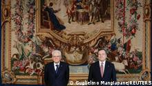 Italian President Sergio Mattarella and Prime Minister Mario Draghi pose for a picture after the new cabinet ministers swearing-in ceremony, at the Quirinale Presidential Palace in Rome, Italy, February 13, 2021. REUTERS/Guglielmo Mangiapane/Pool