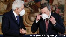 Prime Minister Mario Draghi adjusts his face mask next to Italian President Sergio Mattarella after the new cabinet ministers swearing-in ceremony, at the Quirinale Presidential Palace in Rome, Italy, February 13, 2021. REUTERS/Guglielmo Mangiapane/Pool